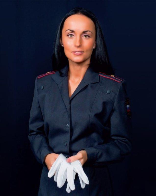 Bright police woman Volk Irina