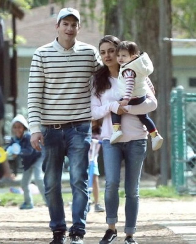 Happy family. Ashton Kutcher and Kunis with their baby