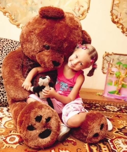 Katya Starshova and her favorite teddy bear Bublik