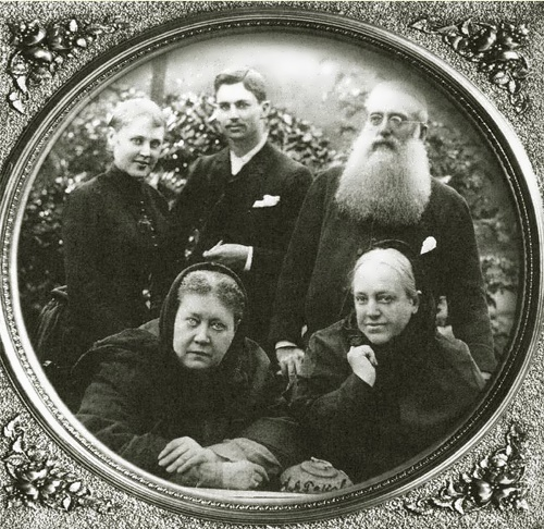 Vera, Charles Johnston and Henry Olcott standing behind Madame Blavatskaya and her sister, Vera Jelihovskaya. London 1888