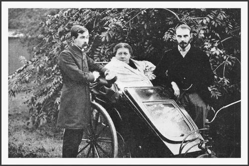 Blavatskaya in her chair beside the publisher James Pryce and his secretary George Robert Stowe Mead