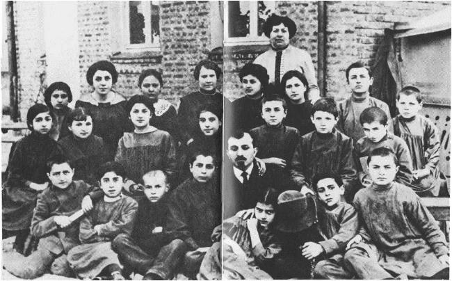 Aram Khachaturyan (second from left) among the students of the boarding school