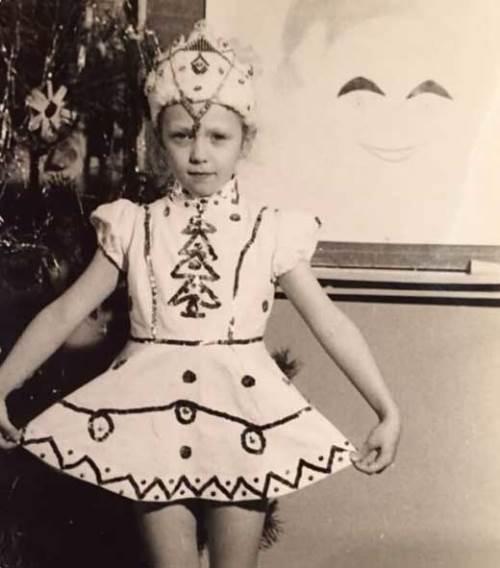 Cute Albina Dzhanabaeva in her childhood