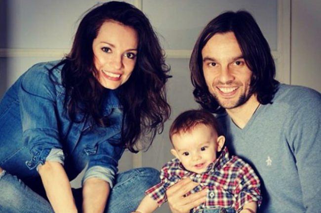 Happy family. Svetlana Svetikova and Alexey Polishchuk with their son