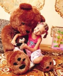 Katya Starshova and her favorite teddy bear Bublik