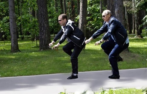 Vladimit Pudin and Dmitry Medvedev. Invisible bicycle