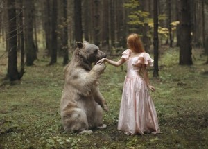 Fragile girl and the symbol of the country, Russian bear Plotnikova