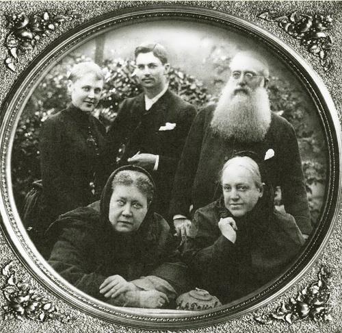 Vera, Charles Johnston and Henry Olcott standing behind Madame Blavatskaya and her sister, Vera Jelihovskaya. London 1888